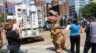 A T-rex walks the streets of Downtown Pittsburgh